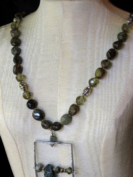 Framed Wire Pendant and Green Garnet Necklace